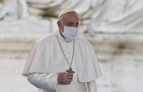 Pope Francis wears a mask